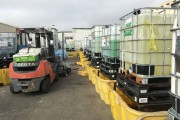 Forklift and bins of waste