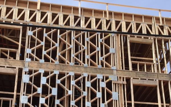 Building under construction with wood showing